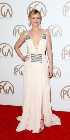 Jennifer Lawrence at the 26th Annual Producers Guild Of America Awards in L.A. (January 24, 2015). She´s wearing a Prada dress, Lapis and Rainbow Moonstone Drop Earrings by Irene Neuwirth, a Crystal Statement Ring from Shay Accessories and Prada shoes. #jenniferlawrence #style