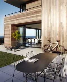 Contemporary Beach House by Smart Design Studio cedar cladded house garden I like the cedar cladding