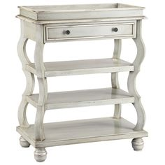 Parisian elegance pairs with a country chic aesthetic in the beautiful Buster Accent Table. A perfect summer vignette for wildflowers and vintage décor this lovely Stein World piece features gently undulating silhouette on bun feet, while a hand-painted finish in gray brings rich vintage appeal.
