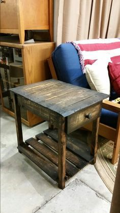 Reclaimed pallet end table with a tapped rail road spike drawer pull. Visit http://www.gotwoodworkshop.com/pallet-wood-end-table to see how it's made!