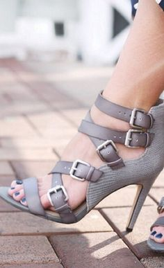 High heeled sandals crafted from two textures with multiple buckle straps, open toe and easy back zipper.