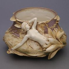 Art Nouveau Turn Teplitz Porcelain Vase~~Austrian Art Nouveau Turn Teplitz Porcelain Vase with a Nymph Figure Emerging from a Blooming Flower, Early 20th Century {Height 6 1/4 inches, maximum diameter 10 inches} [Repair]