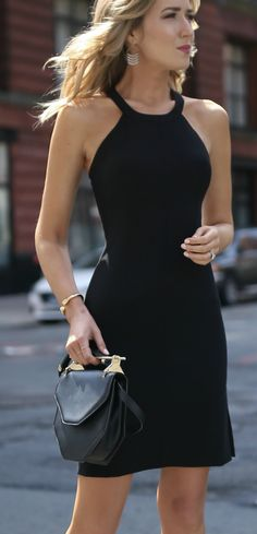 Complete guide to the BEST little black dresses you need for date night and cocktail parties // cross back LBD with slit, wrapped ankled strap heeled sandals, amor fati bag, chandelier earrings, classic style {elizabeth and james, m2malletier}