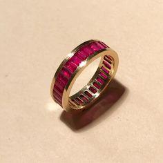 A Burmese ruby eternity ring by Luis Miguel Howard.