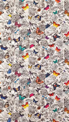 """This fabric and wallpaper print """"Butterfly Garden"""" just debuted in Osborne & Little's latest Spring collection. We love the contrast of the black and white floral backdrop with the vibrantly colored butterflies."""