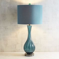 With a ribbed glass base and matching drum shade, our Ariana lamp is the perfect example of a tone-on-tone decorative accent. And if its tempting teal hue isn't reason enough to love it, perhaps the three-way switch will sweeten the deal.