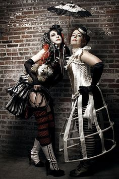 A mix of steampunk and circus with a big dash of boudoir and cabaret.