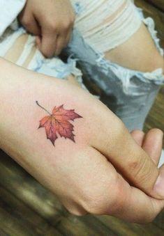 small leaf hand tattoo