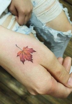 small leaf hand tattoo