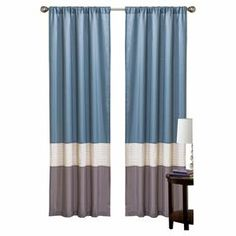 "Color-blocked curtain with a rod pocket design.  Product: Set of 2 curtainsConstruction Material: PolyesterColor: BlueFeatures: Rod pocketDimensions: 84"" H x 42"" W eachCleaning and Care: Dry clean"