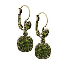 I have earrings similar to these, only with yellow topaz gemstones. (1900s Olivine Art Nouveau Lever Back Earrings)