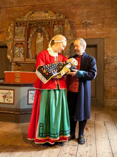 Church at Borås Museum, baptism of a child. The Godmother and Godfather are dressed in folk costumes from Toarp in Västergötland.