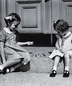 Sitting on the stoop with your best friend. Remember wearing dresses to go out and play. Those were the good old days before electronic life took over.