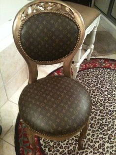 My Louis Vuitton vanity chair in my bathroom- LOVE IT!!  I recovered the old chair with a LV garment bag that I never used- much used now!!