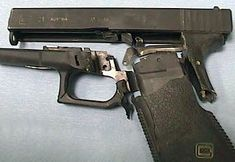 A Glock Model 21 .45 acp. pistol appears to have been destroyed using faulty hand loaded ammunition.