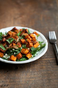 Roasted Sweet Potato, Spinach, and Quinoa Salad. Could be great with Arugula also!