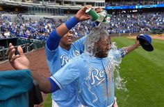 Kansas City Royals' Lorenzo Cain (6) gets a small dunking by Salvador Perez (13) after the teams 4-2 win over the Oakland Athletics during Sunday's baseball game on April 19, 2015 at Kauffman Stadium in Kansas City, Mo.
