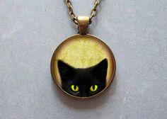 Gato negro mirando cara ilustraciones colgante, usable
