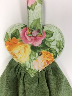 This towel has a rose button handle that can hang from a refrigerator,oven or anywhere you like. Lined with a double thickness of polyester fleece interfacing to give it stability. DIMENSIONS: LENGHT: 21 HEART: 7w x 6-1/4l TOWEL: 16w x 14l HANDLE: 1-3/4 w x 9l( buttoned- 1-3/4x 3-1/2)  PLEASE WASH AND DRY ON COOL SETTINGS WITH SIMILAR COLORS PRESS WITH A WARM IRON IF NEEDED ❤️❤️❤️HAND CRAFTED IN A SMOKE FREE ENVIRONMENT ❤️❤️❤️  Because this is a handmade item, fabric patte...