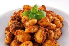 Traditional Italian Gnocchi with Meat Sauce (Gnocchi al Ragu)   Enjoy this authentic Italian recipe from our kitchen to yours. Buon Appetito!