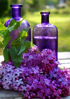I HAVE A PURPLE BOTTLE LIKE THOSE, MEDICINE USED TO COME IN THEM... AND OVER TIME, THEY CAN GET DARKER.. also LOVELY LILAC!