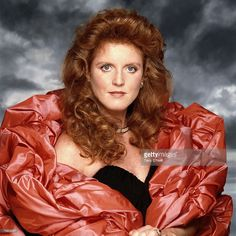 Sarah Ferguson, Duchess of York, surrounded by a volumious lobster pink wrap, circa 1990.