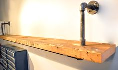 Simple pipe shelves installed on a wall. I think we're going to need these.