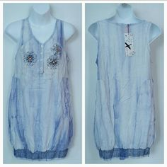"Tie Dye Dress NWT Brand new with tags Tie dye is hot this season! This dress features beaded and embroidered details and elastic banding at the bottom for added details. So perfect to grab for your day around town! 100%rayon Approx 32"" Tie dye print will vary with each dress, no two dress will be the same. Dresses"