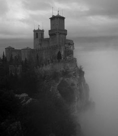 It looks like a castle from a fairy tale. but it's taken in San Marino on a foggy and rainy day in april fairy tale castle The Places Youll Go, Places To See, Dark Castle, Famous Castles, Fairytale Castle, Enchanted Castle, Beautiful Castles, Beautiful Buildings, Beautiful Homes