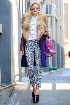 leopard pants, a polka dot top and color-block coat that all come together without looking over the top