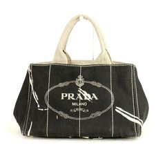 Prada canapa black and white tote bag  great condition with dustbag  white splatters throughout  signature Prada plaque  asking $355  comment for more information or to purchase this item