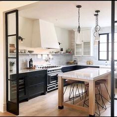 This kitchen is stunning! I love your cool hood and those black iron doors!… – Kitchen World Kitchen Interior, New Kitchen, Kitchen Decor, Kitchen Modern, Glass Kitchen, Design Kitchen, White Wood Kitchens, Cuisines Design, Beautiful Kitchens