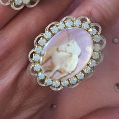 Unicorn Fantasy Ring Behold these lovely, pastel-y, fantasy rings. Each one features a different combination of cameo, rhinestones, and laser cut cameo setting. They are attached to silver, adjustable band and can fit most finger sizes. Kawaii Jewelry Rings