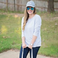 Vineyard Vines Striped Grey Heather Knot Top Tee This long sleeved tee is very soft and lightweight. It fits more like a medium in my opinion. Grey and white stripes. Vineyard Vines Tops Tees - Long Sleeve