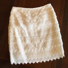 """Tiered Lace Pencil skirt - white Pretty and feminine new white lace pencil skirt. Never been worn! New excellent condition. 100% Cotton. Comfortable and fully lined. Approx. 17"""" long. Cross grain ribbon at waist. Hidden side white zipper with hook-and-eye closure. ❤️ White House Black Market Skirts Pencil"""