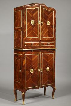 """A late 18th century wooden veneer piece of furniture for keeping papers called """"cartonnier"""", in its upper part two drawers and a pair of side doors adorned with delicate pull..."""