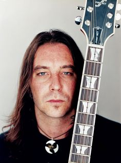 Matt Pike (High on Fire, Sleep) with a tiny soul patch and a big signature 9 sting guitar.