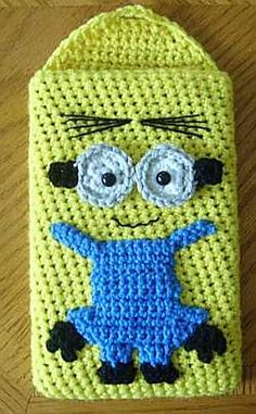 "Minion Nook Kindle Tablet Sleeve by Knotty Hooker Designs - This pattern is available for $2.50 USD. Protect your portable device with style!  This is a written pdf pattern for my Minion Sleeve.  Finished size is appx. 5 1/2"" wide by 8 1/2' long.  It is designed to fit Nook, Kindle & 7"" Tablets."