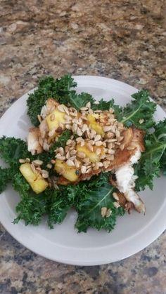 4 oz Tilapia, 2 oz kale, 1 oz pineapple & 20 g sunflower seeds - 180 calories