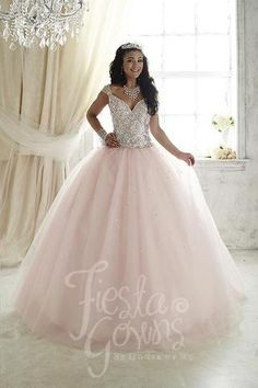 Illuminated by shining, colorful beads on its sweetheart bodice, this gown has…