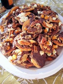 Ritz Cracker Candy: 1 to 2 sleeves of Ritz crackers, 1 1/2 cup unsalted butter, 1 1/2 cup firmly packed brown sugar, 1/2 cup chocolate chips, 1/2 cup chopped pecans, 1/2 cup peanut butter chips/white chocolate chips.!!