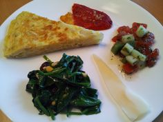 Clockwise from top: piquillo pepper stuffed with manchego cheese (pan-seared and drizzled with scallion vinaigrette), Israeli salad, queso tetilla (from Galicia), spinach with raisins and pine nuts, and tortilla española.