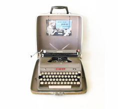 This is the exact model I had during college - same color, same case. And it was my dad's college typewriter before that! ~~ Royal Typewriter Quiet Deluxe Portable w/ Manual & Receipt Working