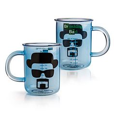 """$12.99 Breaking Bad Beaker Mug •Glass Breaking Bad Beaker Mug  •Officially-licensed Breaking Bad merchandise  •Mug features measurements in milliliters and the face of Heisenberg  •Not ideal for cooking up """"the blue,"""" but makes a great gift  •Goes great with a blue rock candy stirrer  •Materials: Glass  •Not dishwasher or microwave safe  •Ages 12+"""