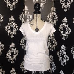 Basic White V-neck Tee Basic White V-neck Tee, great condition! No stains or marks, only worn once. Smoke free home. No Boundaries Tops Tees - Short Sleeve