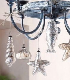 9 Easy Christmas Holiday Decorations with a Nod to Nautical and the Beach. Deck out a chandelier with ornaments!