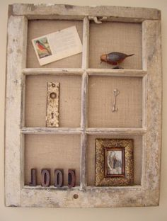 Love this creative wall display idea using a vintage window.
