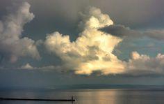 A sunlit storm cloud over the bay of Kvarner, Rijeka, Croatia.