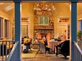 It seems that all we talk about are front porches. Of course that is where we enter a home, and if that home is in a neighborhood, the front porch is the public face of the home. Outdoor Living Rooms, Outdoor Spaces, Indoor Outdoor, Outdoor Dining, Rustic Outdoor, Porch Fireplace, Fireplace Design, Double Fireplace, Country Fireplace