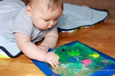Tummy time Sensory Bag for Baby -- love this! use with supervision, of course, but get that tummy time in!!
